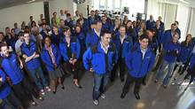 Vancouver, BC - May 21, 2009 - Brian Scudamore, (center)founder and CEO of 1-800-GOT-JUNK, stands amongst staff during a group rally in the lunchroom of their company offices in downtown Vancouver May 22, 2009. At 10:55 a.m., a large group of employees gather for a daily huddle where they have a seven-minute conversation when they talk about plans and ideas. (Jeff Vinnick/The Globe and Mail)
