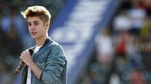Singer Justin Bieber speaks on stage to introduce singer Carly Rae Jepsen (not pictured) at the 2012 Wango Tango concert at the Home Depot Center in Carson, California May 12, 2012. (MARIO ANZUONI/Mario Anzuoni / Reuters)