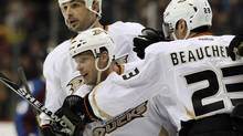 Anaheim Ducks centre Saku Koivu, front, and defenceman Sheldon Souray. (David Zalubowski/The Associated Press)