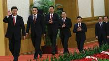 China's new Politburo Standing Committee members (from L to R) Xi Jinping, Li Keqiang, Zhang Dejiang, Yu Zhengsheng, Liu Yunshan, Wang Qishan and Zhang Gaoli, arrive to meet with the press at the Great Hall of the People in Beijing, November 15, 2012. China's ruling Communist Party unveiled its new leadership line-up on Thursday to steer the world's second-largest economy for the next five years, with Vice President Xi Jinping taking over from outgoing President Hu Jintao as party chief. (China Daily/Reuters)