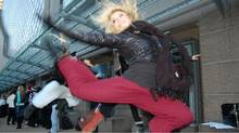 A dancer shows off her moves outside The Centre in Vancouver for Performing Arts