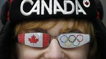 A Canadian fan celebrates Canada's gold-medal hockey victory in Vancouver on Feb. 28. (Kevin Frayer/The Associated Press)