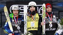 First-place finisher Mikael Kingsbury of Canada, center, poses with second-place finisher Patrick Deneen of the United States, left, and Philippe Marquis of Canada, third place, during a medal ceremony after the men's moguls World Cup freestyle skiing event in Wilmington, N.Y., on Thursday, Jan. 19, 2012. (Mike Groll/AP)
