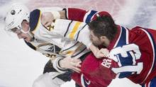 Montreal Canadiens' Mike Brown fights with Buffalo Sabres' Nicolas Deslauriers during NHL hockey action in Montreal on March 10, 2016. (Graham Hughes/THE CANADIAN PRESS)