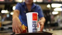Food-industry giants McDonald's and Coca-Cola report substantial declines in earnings as consumers aim to purchase healthier, more sustainable products. (Justin Sullivan/Getty Images)