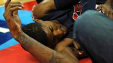 USA Team Blue guard Paul George lays on the floor after injuring his leg during the USA Basketball Showcase at Thomas & Mack Center in Las Vegas on Aug. 1. (Stephen R. Sylvanie/USA Today Sports)