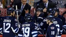 New Winnipeg Jets head coach Paul Maurice and assistant coach Charlie Huddy instruct the team during first period NHL action against the Phoenix Coyotes' in Winnipeg, Monday, January 13, 2014. (Trevor Hagan/THE CANADIAN PRESS)