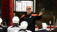 The new Anaheim Ducks new head coach Bruce Boudreau, center, conducts his first practice with the NHL team on Thursday, Dec. 1, 2011, at the Anaheim Rinks facility in Anaheim, Calif. (Leonard Ortiz/AP)