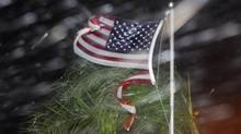 An American flag is ripped to shreds from heavy rain and wind from Hurricane Matthew early Friday, Oct. 7, 2016 in Cape Canaveral, Fla. (Craig Rubadoux/AP)
