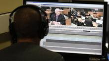 A journalist edits tape from the testimony of Gilles Cloutier at the Charbonneau Commission. (Christinne Muschi for The Globe and Mail) (Christinne Muschi For The Globe and Mail)