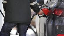 File photo of a man pumping gas in Toronto (MARK BLINCH/REUTERS)