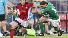 Team Canada wing James Pritchard, left, breaks a tackle against Team Ireland wing Fergus McFadden, right, during first half of an international friendly rugby match in Toronto on Saturday, June 15, 2013. (Nathan Denette/THE CANADIAN PRESS)
