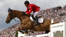 Canada's Eric Lamaze rides Derly Chin De Muze  during the equestrian individual jumping third qualifier in Greenwich Park at the London 2012 Olympic Games August 6, 2012. (Reuters)
