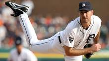 Justin Verlander of the Detroit Tigers throws a pitch against the Detroit Tigers in the first inning of Game Five of the American League Championship Series at Comerica Park on October 13, 2011 in Detroit. (Gregory Shamus/2011 Getty Images)