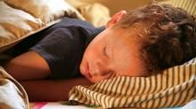 Little boy fast asleep. (Micah Weber/iStockphoto)