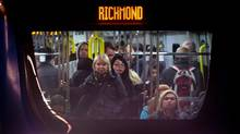 Commuters look out from a Canada Line train car as it arrives at the Oakridge-41st Avenue Station at the end of the work day in Vancouver, B.C., on Wednesday April 16, 2014. (DARRYL DYCK/THE GLOBE AND MAIL)