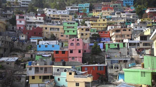 Workers this month began painting the concrete façades of buildings in Jalousie slum a rainbow of colours. (Dieu Nalio Chery/Associated Press)