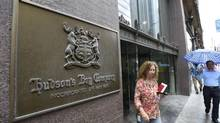 A woman walking out of the Hudson's Bay Company store at Queen St. West and Yonge St. in Toronto on July 3 2014. (FRED LUM/THE GLOBE AND MAIL)