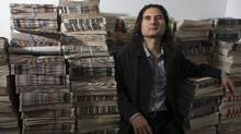 """James Sears is pictured, amongst back copies of """"Your Ward News"""" , in the newspapers' shuttered offices in Toronto on Tuesday June 7 2016. (Chris Young for The Globe and Mail)"""