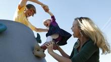 Brandi Diehl, her daughter Brooklyn and son Tyler play in the park in Airdrie, Alta. (Todd Korol for The Globe and Mail)