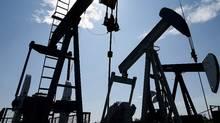 Pumpjacks at work pumping crude oil in Alberta. (Larry MacDougal/THE CANADIAN PRESS)
