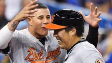 Baltimore Orioles' Hyun Soo Kim, right, is congratulated by teammate Manny Machado on his two-run homer against the Jays during ninth inning on Wednesday. (Frank Gunn/THE CANADIAN PRESS)