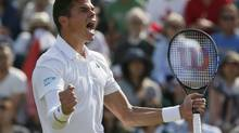 Milos Raonic of Canada reacts after defeating Kei Nishikori of Japan in their men's singles tennis match at the Wimbledon Tennis Championships, in London July 1, 2014. (STEFAN WERMUTH/REUTERS)