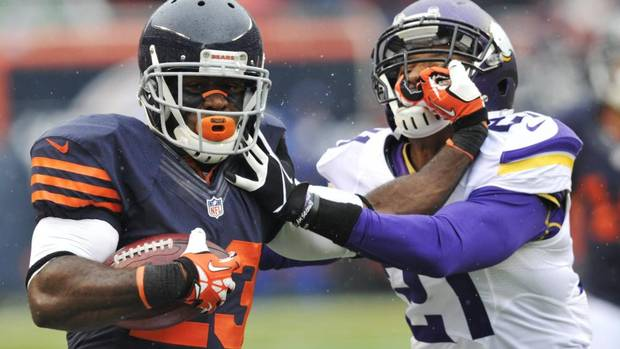 Chicago Bears' Devin Hester (23) pushes off Minnesota Vikings' Josh Robinson (21) while running a kickoff return during the first half of an NFL game on Sunday, Sept. 15, 2013, in Chicago. A Jay Cutler TD pass with 10 seconds remaining in the fourth quarter propelled the Bears to a 31-30 win over the Vikings. (JIM PRISCHING/AP)
