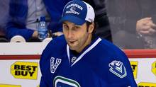Vancouver Canucks goalie Roberto Luongo comes off the bench after the team defeated the Colorado Avalanche during an NHL hockey game in Vancouver, B.C., on Thursday March 28, 2013. (The Canadian Press)