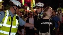 Police detain a protester during a demonstration against tuition fee hikes in Montreal May 23, 2012. (OLIVIER JEAN/OLIVIER JEAN/REUTERS)