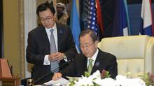 UN Secretary General Ban Ki-moon, right, prepares ahead of the opening ceremony of the International Humanitarian Pledging Conference for Syria at Bayan Palace on the outskirts of Kuwait City on Jan. 30 (STEPHANIE MCGEHEE/REUTERS)
