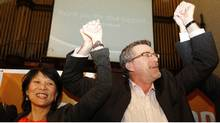 NDP MP Olivia Chow celebrates with law professor Craig Scott, the party's new candidate in a by-election in the old Toronto-Danforth of Ms. Chow's now-deceased husband, Jack Layton. (Fernando Morales/The Globe and Mail)