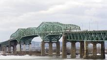 The Champlain Bridge spanning the Saint Lawrence River in Montreal is seen in a March 2011 file photo. (Graham Hughes/THE CANADIAN PRESS)