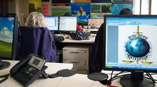 Workers control information coming from other country members in the command and coordination room of the International Criminal Police Organization. (JEAN-PHILIPPE KSIAZEK/AFP/Getty Images)