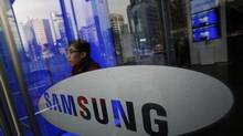 A man walks out of Samsung Electronics' headquarters in Seoul on January 6, 2014. (KIM HONG-JI/REUTERS)
