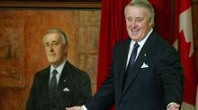Former prime minister Brian Mulroney poses alongside his portrait after its unveiling on Parliament Hill in Ottawa in 2002. (TOM HANSON/CP)