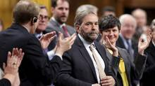 New Democratic Party leader Thomas Mulcair receives a standing ovation from his caucus during Question Period in the House of Commons on Parliament Hill in Ottawa April 22, 2015. (CHRIS WATTIE/REUTERS)