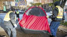 City of Vancouver workers remove an unoccupied tent at the Occupy Vancouver site on the Vancouver Art Gallery grounds November 15, 2011. (JOHN LEHMANN/JOHN LEHMANN/THE GLOBE AND MAIL)