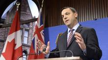 Ontario Progressive Conservative Leader Tim Hudak talks to media at Queen's Park in Toronto on Thursday, March 27, 2014. (Frank Gunn/THE CANADIAN PRESS)