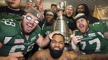 Saskatchewan Roughriders celebrate after beating the Hamilton Tiger-Cats to win the Grey Cup on November 24, 2013 in Regina. The Roughriders were the only team to surpass the CFL's 4.4-million salary cap in 2013, the league announced Wednesday. (Frank Gunn/THE CANADIAN PRESS)