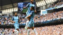 Raheem Sterling of Manchester City celebrates scoring the opening goal with Nolito during the Premier League match against West Ham United at Etihad Stadium on Aug. 28, 2016. (Gareth Copley/Getty Images)