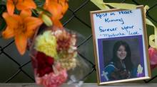 A photo of Kimberly Proctor, an 18-year-old from Langford whose burned body was found Friday at Millstream Creek beneath the Galloping Goose Trail along the Langford-Colwood border, sits at a memorial near the location she was discovered. (Geoff Howe For The Globe and Mail/Geoff Howe For The Globe and Mail)