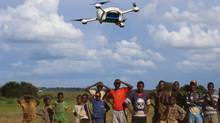 Local children in Malawi look on during a demonstration flight of a UAV (drone) in advance of a trial aimed at improving HIV diagnosis. The trial started Monday. (UNICEF)