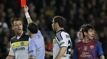 Chelsea's John Terry, third left, gets a red card from referee in between players Bduring a Champions League second leg semifinal soccer match against Barcelona at Camp Nou stadium, in Barcelona, Spain, Tuesday, April 24, 2012. (AP Photo/Andres Kudacki) (Andres Kudacki/AP)