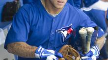 Toronto Blue Jays Brett Lawrie gathers his gear after finishing play in the fifth inning of their MLB baseball spring training game against the Tampa Bay Rays in Dunedin, Florida March 1, 2013. (FRED THORNHILL/REUTERS)