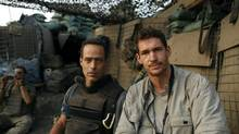 The late Tim Hetherington, right, with friend and collaborator Sebastian Junger in Afghanistan. (Reuters)