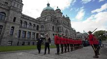 Lieutenant Governor Steven Point waves to the crowd as he inspects the honor guard prior to delivering the Speech from the Throne at the Legislature in Victoria, B.C. Monday, Oct. 3, 2011. (JONATHAN HAYWARD/THE CANADIAN PRESS)
