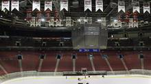 As the team's 24 Stanley Cup banners and seven retired sweaters hang from the rafters, a Zamboni cleans the ice at the Bell Center in Montreal in this file photo. (RYAN REMIORZ/CP)