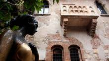 The bronze statue of Juliette Capulet stands near the balcony of her house in central Verona. (MAURIZIO LAPIRA/AFP/Getty Images)