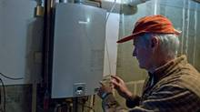 """Dave Braden believes his home near Freelton is one of the most energy efficient homes in Canada. Braden uses a propane opperated """"on demand,"""" hot water heater and well water. (Glenn Lowson/Glenn Lowson for The Globe and Mail)"""